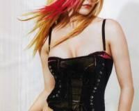 Гламурная блондинка в черном сексуальном корсете